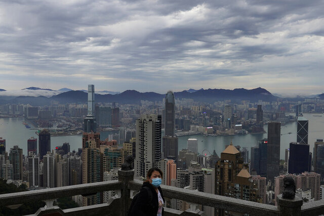 A woman wears protective face mask at the Peak, a popular tourist spot in Hong Kong, Thursday, Feb. 13, 2020. COVID-19 viral illness has sickened tens of thousands of people in China since December. (AP Photo/Vincent Yu)