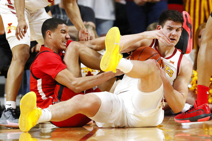 Iowa State forward Michael Jacobson, right, fights for a loose ball with Texas Tech guard Kevin McCullar during the first half of an NCAA college basketball game Saturday, Feb. 22, 2020, in Ames, Iowa. (AP Photo/Charlie Neibergall)