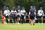 Chicago Bears players warm up during NFL football practice in Lake Forest, Ill., Wednesday, July 28, 2021. (AP Photo/Nam Y. Huh)