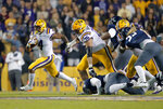 LSU running back Nick Brossette (4) carries as offensive lineman Austin Deculus (76) blocks behind him in the first half of an NCAA college football game against Rice in Baton Rouge, La., Saturday, Nov. 17, 2018. (AP Photo/Gerald Herbert)