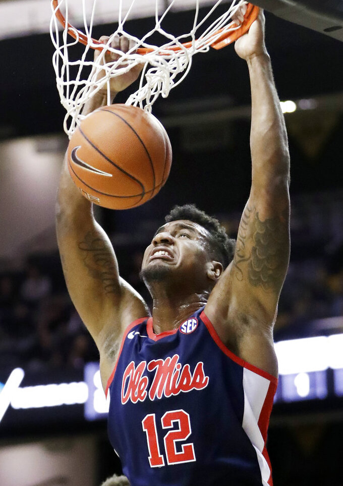 Mississippi forward Bruce Stevens dunks the ball against Vanderbilt in the second half of an NCAA college basketball game Saturday, Jan. 5, 2019, in Nashville, Tenn. (AP Photo/Mark Humphrey)