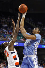 North Carolina forward Garrison Brooks (15) shoots over Syracuse forward Bourama Sidibe during the first half of an NCAA college basketball game at the Atlantic Coast Conference tournament in Greensboro, N.C., Wednesday, March 11, 2020. (AP Photo/Ben McKeown)