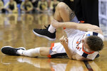 Virginia's Kyle Guy holds his ankle during the first half of the men's NCAA Tournament college basketball South Regional final game against Purdue, Saturday, March 30, 2019, in Louisville, Ky. (AP Photo/Timothy D. Easley)
