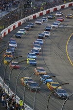 Kevin Harvick, lower right, leads the field at the start of the NASCAR Cup series auto race at Richmond Raceway in Richmond, Va., Saturday, April 13, 2019. (AP Photo/Steve Helber)