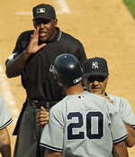 FILE - In this July 3, 2004, file photo, home plate umpire Chuck Meriwether, left, talks to New York Yankees' Jorge Posada (20) as manager Joe Torre gets between them after Posada was called out on strikes with the bases loaded to end the ninth inning of a baseball game against the New York Mets at Shea Stadium in New York. Meriwether, a former major league umpire who had been ill with cancer, died Saturday, Oct. 26, 2019, at his home in Nashville, Tenn. He was 63. Meriwether called his first big league game in 1987, was promoted to the full-time American League staff in 1993 and worked for 18 years. He then became a major league umpire supervisor for nine years. (AP Photo/Bill Kostroun, File)