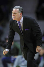 TCU head coach Jamie Dixon works the sidelines during the first half of an NCAA college basketball game against Kansas State in Manhattan, Kan., Tuesday, Jan. 7, 2020. (AP Photo/Orlin Wagner)
