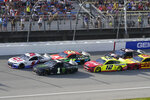 Kyle Larson (5) leads the field during a restart at the NASCAR Cup Series auto race at Michigan International Speedway, Sunday, Aug. 22, 2021, in Brooklyn, Mich. (AP Photo/Carlos Osorio)