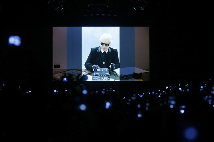 A video presentation showing the late designer Karl Lagerfeld and his association with Fendi is shown after the Fendi women's Fall-Winter 2019-2020 collection, that was presented in Milan, Italy, Thursday, Feb.21, 2019. (AP Photo/Antonio Calanni)