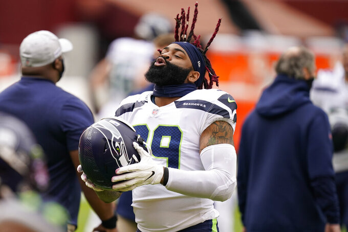 Seattle Seahawks tight end Will Dissly (89) flips his hair before the start of an NFL football game against the Washington Football Team, Sunday, Dec. 20, 2020, in Landover, Md. (AP Photo/Andrew Harnik)