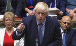 In this handout photo provided by the House of Commons, Britain's Prime Minister Boris Johnson speaks in Parliament in London, Wednesday, Sept. 25, 2019. British lawmakers returned to the House of Commons on Wednesday, venting their pent-up anger over Prime Minister Boris Johnson's failed attempt to suspend Parliament and warning that democracy itself is under threat from the government. (House of Commons via AP)