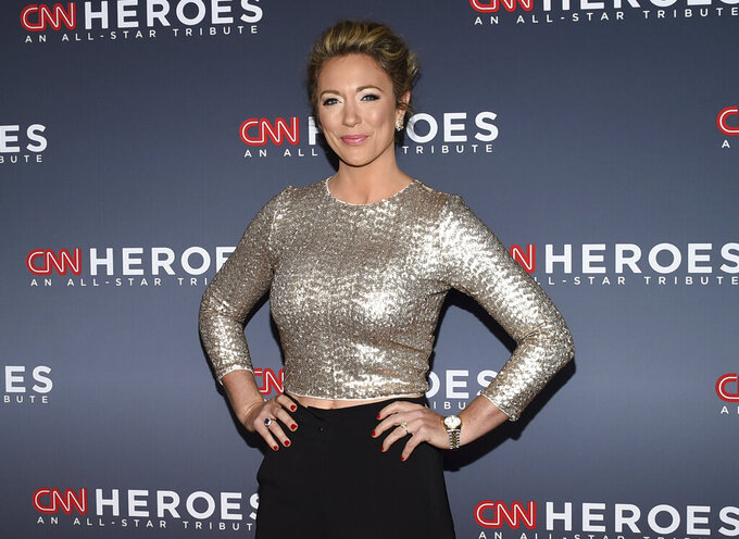 FILE - This Dec. 17, 2017 file photo shows CNN news anchor Brooke Baldwin at the 11th annual CNN Heroes: An All-Star Tribute at the American Museum of Natural History in New York. Baldwin says she's tested positive for the coronavirus. She's the second on-air personality at the news network to come down with the disease in the past week. Prime time host Chris Cuomo has also tested positive and did two of his shows remotely from the basement of his home. Baldwin says the fever, aches and chills that are often a sign of Covid-19 came on suddenly for her. (Photo by Evan Agostini/Invision/AP, File)