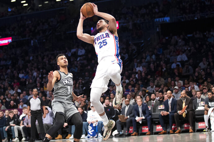 Philadelphia 76ers guard Ben Simmons (25) goes to the basket past Brooklyn Nets guard Chris Chiozza (9) during the first half of an NBA basketball game, Monday, Jan. 20, 2020, in New York. (AP Photo/Mary Altaffer)
