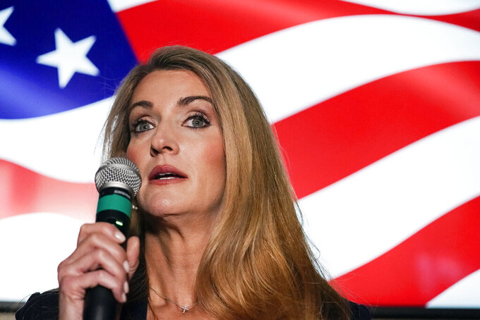 FILE - In this Nov. 13, 2020, file photo Republican candidate for U.S. Senate Sen. Kelly Loeffler speaks at a campaign rally in Cumming, Ga. Loeffler's tight embrace of President Donald Trump and the far right while fighting to hold on to her U.S. Senate seat is not exactly what allies of Georgia Gov. Brian Kemp envisioned when he appointed her to the position in 2019. (AP Photo/Brynn Anderson, File)