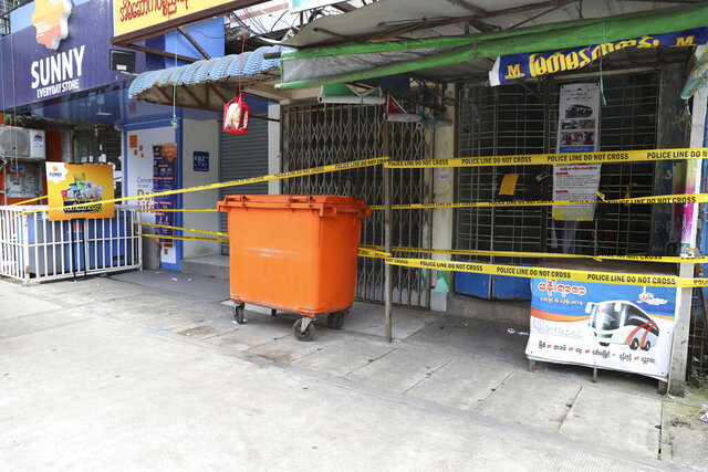 A lockdown building wrapped with yellow police sits shuttered due to the coronavirus in Yangon, Myanmar, Thursday, Sept. 10, 2020. Myanmar is accelerating efforts to control the spread of the coronavirus, which now has impinged on the upcoming November 8 general election, as campaigning has been ordered suspended in several areas locked down to control the spread of the virus. (AP Photo/Thein Zaw)