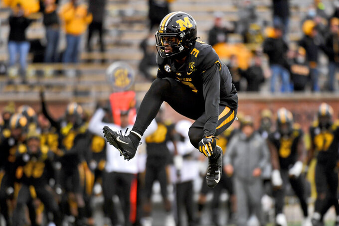 Missouri safety Martez Manuel (3) leaps in the air to celebrate after sacking Georgia quarterback JT Daniels during the first half of an NCAA college football game Saturday, Dec. 12, 2020, in Columbia, Mo. (AP Photo/L.G. Patterson)