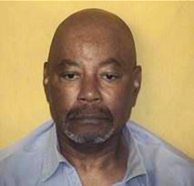 This undated photo provided by the Ohio Department of Rehabilitation and Corrections shows Carlos Ridley. Ridley, serving a life sentence for a triple slaying, was awaiting a court ruling this month he hoped would help him prove innocence through DNA testing. On Monday, May 4, 2020, an Ohio appeals court rejected Ridley's request. The next day, he was rushed to a hospital where he died of COVID-19, according to his two daughters. (Ohio Department of Corrections via AP)