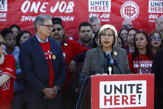 Geoconda Arguello-Kline, right, Secretary-Treasurer of the Culinary Union, speaks at a news conference to announce the union's decision to stay out of the state's Democratic presidential caucuses and not endorse a candidate, Thursday, Feb. 13, 2020, in Las Vegas. (AP Photo/Patrick Semansky)