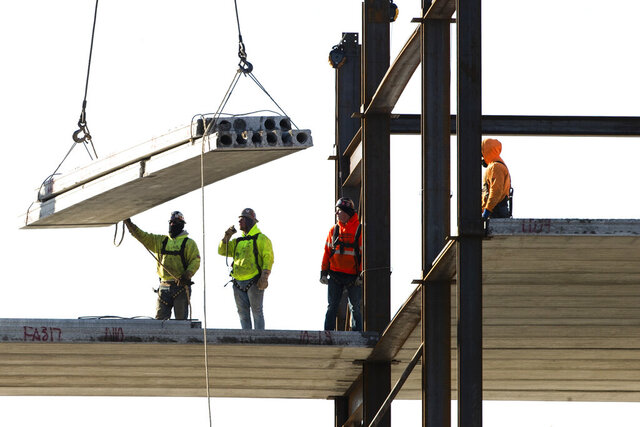 FILE - In this Dec. 3, 2019, file photo, workers erect a building under construction in Philadelphia. U.S. construction spending fell again in June 2020, the fourth straight decline as the coronavirus outbreak continues to wreak havoc on the economy. (AP Photo/Matt Rourke, File)