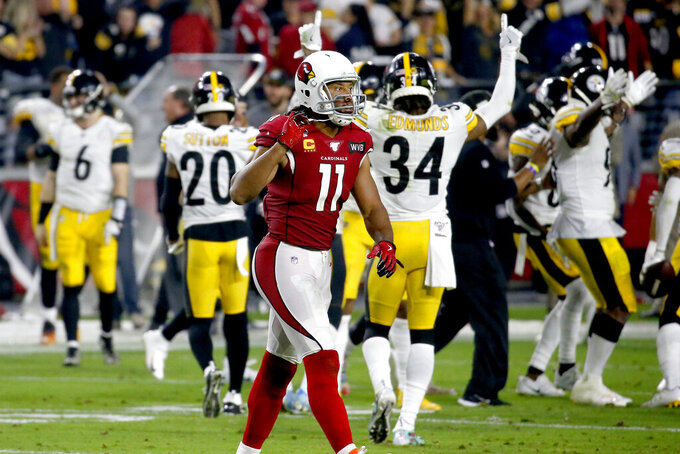 Arizona Cardinals wide receiver Larry Fitzgerald (11) leaves the field after a game-ending interception by the Pittsburgh Steelers during the second half of an NFL football game, Sunday, Dec. 8, 2019, in Glendale, Ariz. The Steelers won 23-17. (AP Photo/Ross D. Franklin)