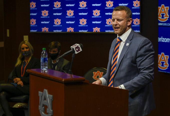 In this photo provided by Auburn Athletics, Bryan Harsin, Auburn's new college football coach, speaks during a conference Thursday, Dec. 24, 2020, in Auburn, Ala. (Todd Van Emst/Auburn Athletics via AP)