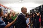 Kevin Faulconer, former San Diego mayor and Republican candidate for governor of California, greets supporters during a news conference after polls closed in the recall election Tuesday, Sept. 14, 2021, in San Diego. (AP Photo/Gregory Bull)
