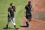 San Francisco Giants' Brandon Crawford, left, walks beside Brandon Belt during a baseball practice on Friday, July 3, 2020, in San Francisco. (AP Photo/Ben Margot)