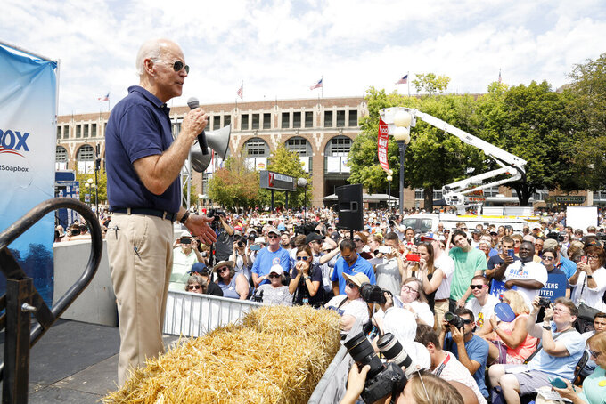 FILE - In this Aug. 8, 2019 file photo, then Democratic presidential candidate former Vice President Joe Biden speaks at the Des Moines Register Soapbox during a visit to the Iowa State Fair in Des Moines, Iowa. With coronavirus cases rising throughout Iowa and around the nation, health experts are becoming increasingly worried about next month's Iowa State Fair, which will bring more than 1 million people to Des Moines. (AP Photo/Charlie Neibergall File)