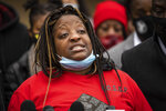 Flanked by family members and attorneys, Clifftina Johnson cries as she talks about her daughter, Tafara Williams, during a press conference outside Waukegan's city hall complex, Tuesday morning, Oct. 27, 2020. Williams, 20, was wounded and her boyfriend, 19-year-old Marcellis Stinnette, was killed when they were both shot by a Waukegan police officer on Oct. 20. Three days after the incident, Waukegan Police Chief Wayne Walles announced that he had fired the officer, saying he'd committed