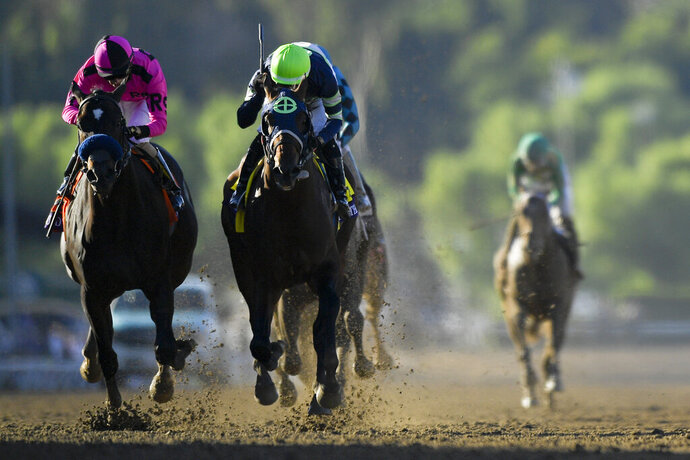 Storm the Court, right, with Flavien Prat, edges out Anneau D'or for the win in the Breeders' Cup Juvenile horse race at Santa Anita, Friday, Nov. 1, 2019, in Arcadia, Calif. (AP Photo/Mark J. Terrill)