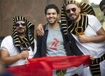 Egyptian soccer fans pose for a photo on the eve of the opener of the 2018 soccer World Cup near Red Square in Moscow, Russia, Wednesday, June 13, 2018. (AP Photo/Alexander Zemlianichenko)
