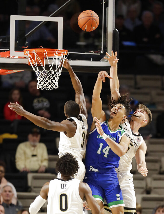Texas A&M-Corpus Christi forward Elijah Schmidt (14) fights for a rebound with Vanderbilt's Maxwell Evans (3) and Oton Jankovic, right, in the first half of an NCAA college basketball game Monday, Nov. 11, 2019, in Nashville, Tenn. (AP Photo/Mark Humphrey)