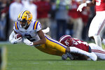 LSU wide receiver Justin Jefferson (2) is tackled by Alabama defensive back Xavier McKinney (15) in the first half of an NCAA college football game, Saturday, Nov. 9, 2019, in Tuscaloosa, Ala. (AP Photo/John Bazemore)