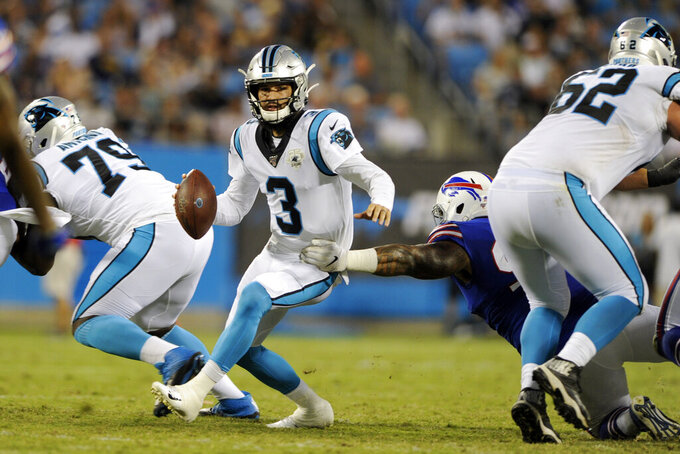 Carolina Panthers quarterback Will Grier (3) scrambles during the first half an NFL preseason football game against the Buffalo Bills in Charlotte, N.C., Friday, Aug. 16, 2019. (AP Photo/Mike McCarn)