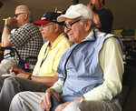 FILE - In this March 5, 2016, file photo, Tommy Giordano, right, special assistant to the general manager of the Atlanta Braves, scouts a spring training baseball game between the Braves and the Pittsburgh Pirates in Kissimmee, Fla. Giordano spent nearly all of his marvelously full life as a baseball man. He's going out like he lived for more than 93 years _ surrounded by family and friends, accompanied by overwhelming love and stories that will endure long after he's gone. (AP Photo/Paul Newberry, File)