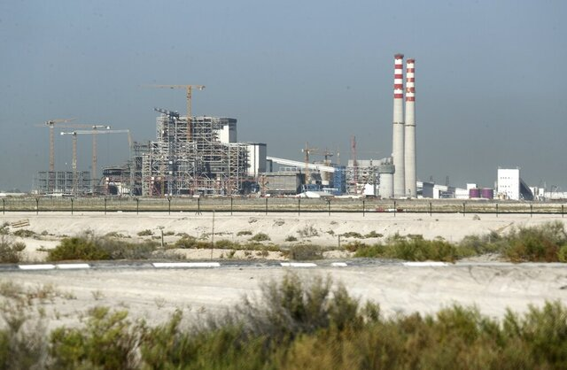 The coal-powered Hassyan power plant is under construction in Dubai, United Arab Emirates, Wednesday, Oct. 14, 2020. In the oil-rich UAE, an unusual sight is rising in Dubai -- a coal-fired power plant, a first for the region. The $3.4 billion Hassyan power plant in Dubai appears puzzling as the UAE hosts the headquarters of the International Renewable Energy Agency. (AP Photo/Kamran Jebreili)