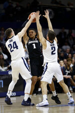 Providence's Makai Ashton-Langford (1) tries to keep the ball away from Villanova's Collin Gillespie (2) and Joe Cremo (24) during the first half of an NCAA college basketball game, Wednesday, Feb. 13, 2019, in Villanova, Pa. (AP Photo/Matt Slocum)