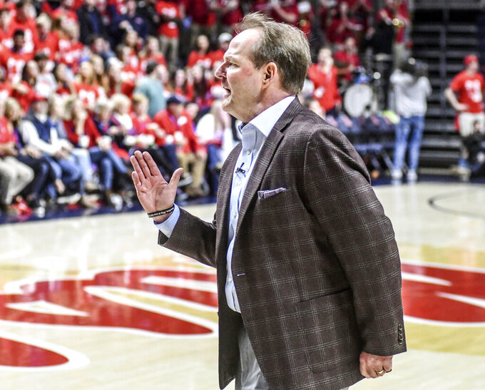Mississippi head coach Kermit Davis talks with a referee during a timeout against Georgia during an NCAA college basketball game in Oxford, Miss., Saturday, Feb. 23, 2019. (Bruce Newman/The Oxford Eagle via AP)