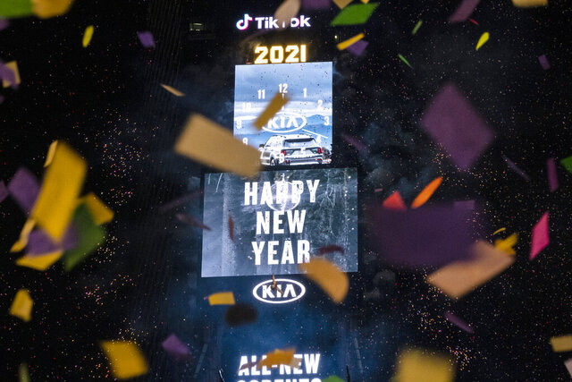 Confetti flies after the Times Square New Year's Eve Ball drops in a nearly empty Times Square, late Thursday, early Friday, Jan. 1, 2021, in New York, as the area normally packed with revelers remained closed off to due to the ongoing coronavirus pandemic. (AP Photo/Craig Ruttle)