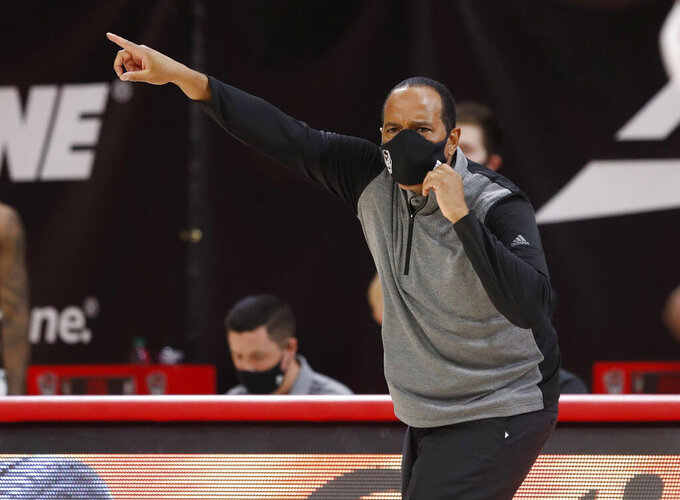 North Carolina State coch Kevin Keatts yells to his team during the first half against North Florida in an NCAA college basketball game in Raleigh, N.C., Friday, Nov. 27, 2020. (Ethan Hyman/The News & Observer via AP, Pool)