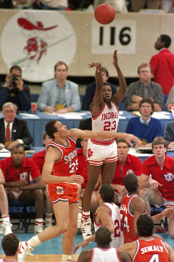 FILE - In this file photo taken March 30, 1987, Indiana's Keith Smart (23) fires a shot past Syracuse's Howard Triche for a basket, putting Indiana ahead by one point in the final seconds of the NCAA college basketball championship game in New Orleans. Indiana defeated Syracuse 74-73. (AP Photo/Bill Haber, File)
