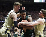 Michigan State forward Xavier Tillman (23) is tied up by Purdue center Matt Haarms (32) and guard Ryan Cline (14) during the first half of an NCAA college basketball game in West Lafayette, Ind., Sunday, Jan. 27, 2019. (AP Photo/Michael Conroy)