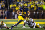 Michigan running back Tru Wilson (13) rushes 27 yards for a touchdown in the fourth quarter of an NCAA college football game against Notre Dame in Ann Arbor, Mich., Saturday, Oct. 26, 2019. Michigan won 45-14. (AP Photo/Tony Ding)