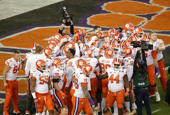 Clemson players huddle before the NCAA college football playoff championship game against Alabama, Monday, Jan. 7, 2019, in Santa Clara, Calif. (AP Photo/Jeff Chiu)