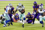 Dallas Cowboys linebacker Jaylon Smith (54) returns a fumble by Minnesota Vikings running back Dalvin Cook during the first half of an NFL football game, Sunday, Nov. 22, 2020, in Minneapolis. (AP Photo/Jim Mone)