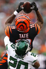 Cincinnati Bengals wide receiver Auden Tate (19) catches a pass against New York Jets free safety Marcus Maye (20) during the first half of an NFL football game, Sunday, Dec. 1, 2019, in Cincinnati. (AP Photo/Gary Landers)