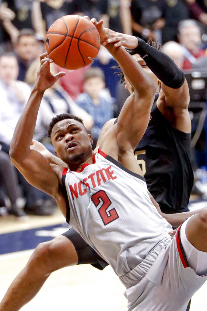 North Carolina State's Torin Dorn (2) shoots as Pittsburgh's Au'Diese Toney, right, defends during the second half of an NCAA college basketball game, Saturday, Feb. 9, 2019, in Pittsburgh. North Carolina State won 79-76. (AP Photo/Keith Srakocic)