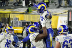Los Angeles Rams' Cam Akers (23) is congratulated after scoring a two-point conversion against the Green Bay Packers during the second half of an NFL divisional playoff football game Saturday, Jan. 16, 2021, in Green Bay, Wis. (AP Photo/Morry Gash)
