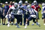 Dallas Cowboys offensive tackle Tyron Smith (77) and defensive end Randy Gregory (94) face off during workouts at the team's NFL football training facility in Frisco, Texas, Wednesday, Aug. 25, 2021. (AP Photo/Tony Gutierrez)