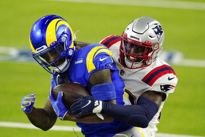Los Angeles Rams running back Cam Akers, left, is tackled by New England Patriots defensive back Devin McCourty during the first half of an NFL football game Thursday, Dec. 10, 2020, in Inglewood, Calif. (AP Photo/Ashley Landis)
