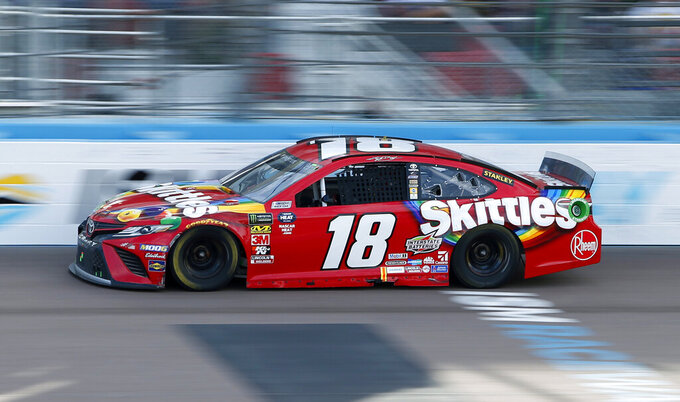 Kyle Busch drives out of Turn 4 during a NASCAR Cup Series auto race at ISM Raceway, Sunday, March 10, 2019, in Avondale, Ariz. (AP Photo/Ralph Freso)